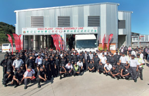 Plant workers pose proudly outside the plant - important initiatives