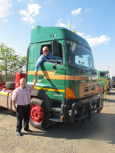 Sampie Swanepoel, the CEO of Transvaal Heavy Transport (THT), gives the thumbs up after an on-road evaluation of the newly delivered Hino 700-Series 2848 truck-tractor to his company's main depot in Alrode. A test drive by the THT CEO of all new trucks delivered to THT is a regular part of the hand-over procedure