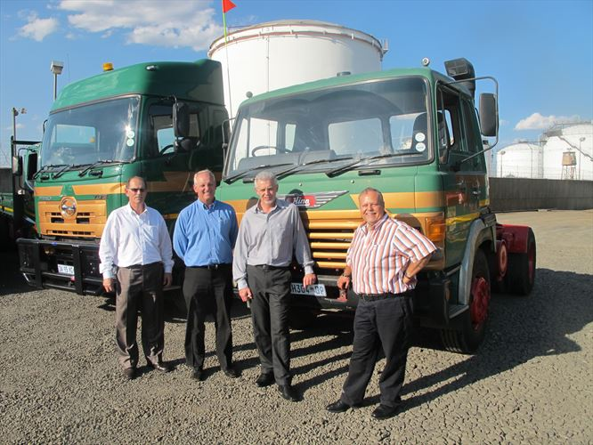 Standing in front of the trucks are (from left) IJ Greeff, General Manager of Hino East Rand, Ernie Trautmann, the Vice President of Hino SA, Frans Cloete, the Divisional Chief Executive – Commercial Vehicles at Unitrans Motors, and Sampie Swanepoel, the CEO of THT