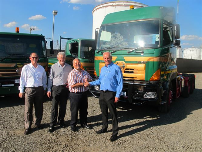Ernie Trautmann (right), the Vice President of Hino SA, congratulates Sampie Swanepoel, the CEO of Transvaal Heavy transport (THT) on the delivery of the latest Hino to join this fleet. Looking on are IJ Greeff (left), the General Manager of Hino East Rand, and Frans Cloete, the at Unitrans Motors. This hand-over continued a long tradition of THT buying its Hino trucks from Hino East Rand, which is part of Unitrans Motors