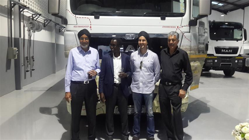 image-6-rt-east-africa-rajinder-and-guest-flank-the-new-tgx-418838 (Small)