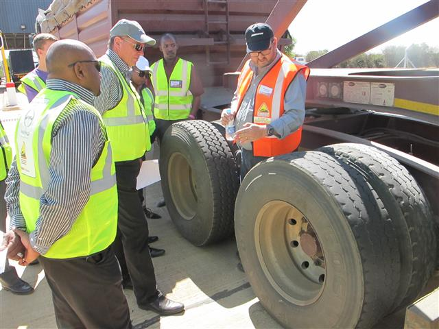 There was a great deal of interest in the explanation by Bridgestone's Steve Norris of the correct tyre management on a truck. Looking on (from left) are Edmund Veeriah, Pieter Klerck, Norah Dlamini and Khaya Mdletshe, all Hino SA team members.