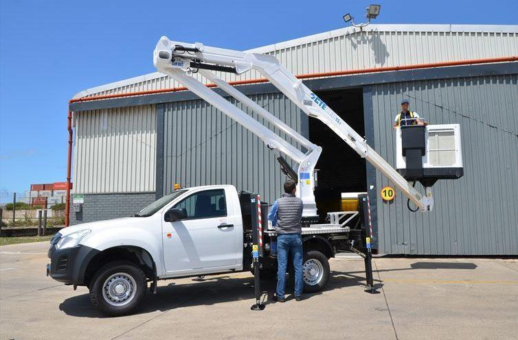 Juan van Rensburg, Kanu Engineering Manager (bottom), tests the functions of aerial platform while Mustafaa Rania, body mounter and welder at Kanu, operates the aerial cab